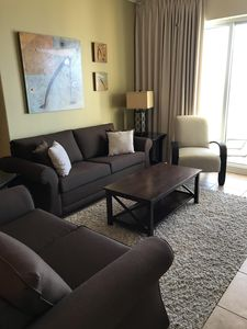 Living area with sleeper sofa and love seat