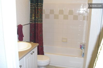Bathroom is tub and shower style.