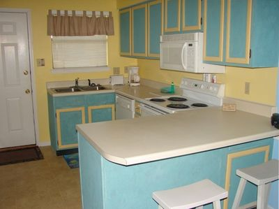 Kitchen with updated appliances, cabinets and microwave