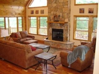 Living room with gas fireplace, soaring ceilings, lots of windows and light!