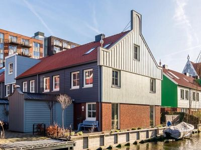 Photo for Beautiful Zaanse style house by the canal very close to Zaandam station