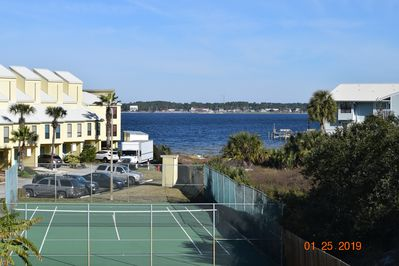 View of the water and tennis court from our over-sized Deck