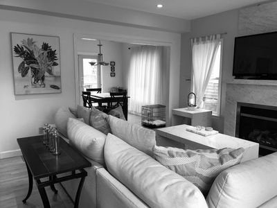 Photo for Spacious & Bright 2BD Condo--A/C, Parking, Private Patio, Short Walk to Commercial