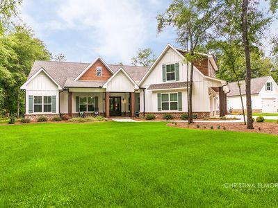 Enjoy this large southern dream home on beautiful lot with Pecan trees.