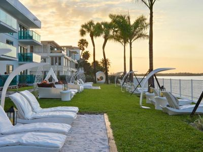 Photo for Walk to The Beach! Spacious 2BR Suite with Kitchen, Pool, Resort Style Amenities