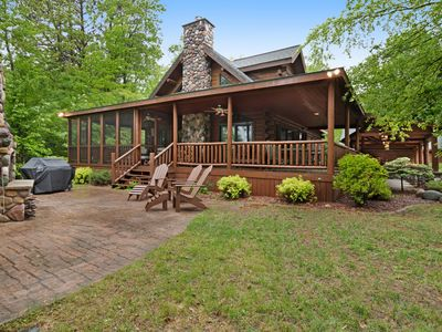 Photo for Quaint lakefront cabin w/ indoor & outdoor fireplace, private dock - dogs OK!