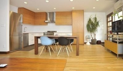 Modern Kitchen / Door To Garden / Large Flat Screen Television On Eames  Cabinet