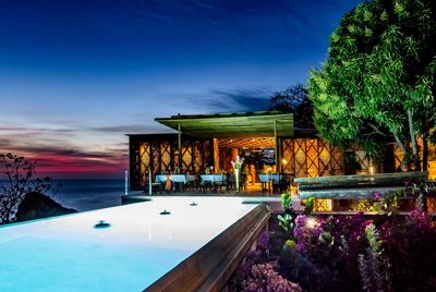 Cosmos Villa at sunset prepared for a dinner function.