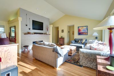 Spacious light filled living w/vaulted ceilings
