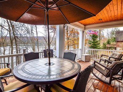 Photo for Private Lakefront with hot tub, game room, detached carriage house!