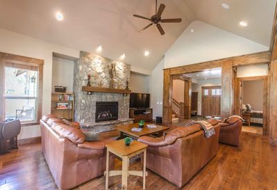 Living room with rock gas fireplace - Welcome to #9 Virginia Rail Lane.  Luxury home with pool table and A/C!