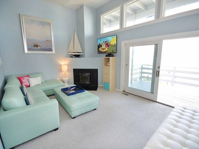 Photo for Beautiful, upscale 3 bedroom townhouse with free WiFi, HBO channels, a boat lift, and impeccable style located right in the bay downtown and just three blocks to the beach!
