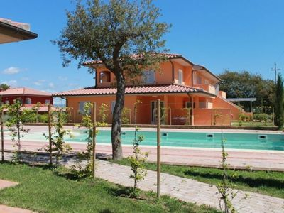 Photo for Lovely apartment for 6 guests with A/C, pool, WIFI, TV, balcony and parking