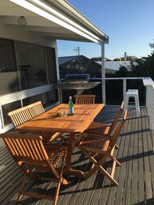 Outdoor dining with sea views, from the elevated deck