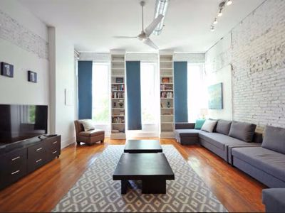 Photo for Downtown Historic Loft- 130yr old exposed brick and hardwood