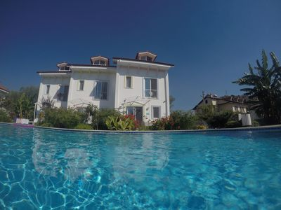 Swimming Pool with Villa Edman behind