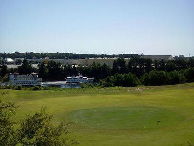 view of Intracoastal Waterway and 14th tee of Greg Norman course from balcony