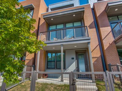 Photo for Luxury townhome with rooftop patio located a block away from the Pearl