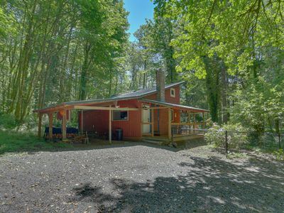 Photo for Peaceful, waterfront, dog-friendly cabin w/ wood stove, spacious deck, and grill
