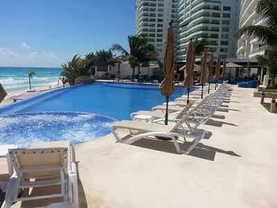 Photo for BEACHFRONT CANCUN CLUB ZONE CONDO IN RESORT