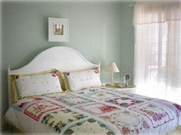 King size bed with french doors leading to porch