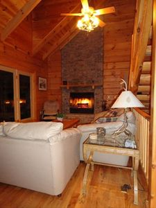 Evenings at the cabin are peaceful next to a roaring fire.