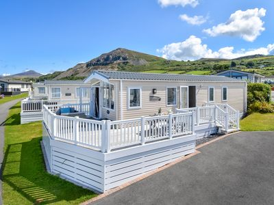 Photo for Contemporary coastal chic lodge in a great location on the family friendly Aberafon Holiday Park in