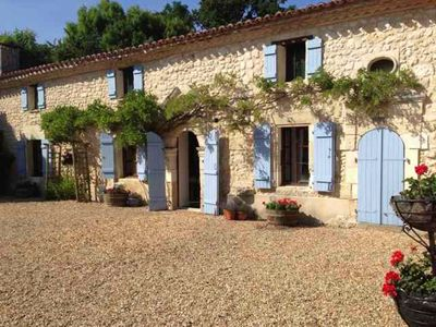 Photo for Apartment in magnificent 16th century farmhouse - pool - stunning views