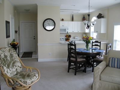 View from Living Room of Dining/Kitchen area and entry way with Central A/C.