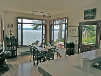 Looking from kitchen through dining area to Skagit Bay and Whidbey Island.
