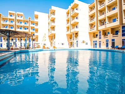Photo for Top Floor with 180° Panoramic Pool View, Balcony and Free WIFI