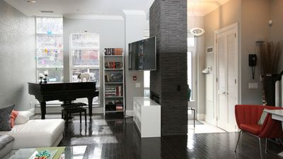 First floor features a lounge area, a flat screen TV and a grand piano