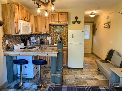 Features a full kitchen and seating for 2.