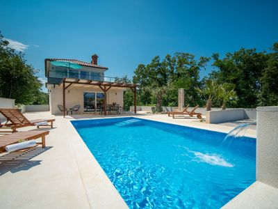 Photo for This 3-bedroom villa for up to 6 guests is located in Dobrinj and has a private swimming pool, air-c