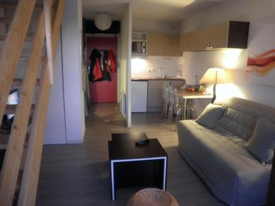 Photo for Surface area : about 23 m². Living room with bed-settee. Sleeping area with 2 bunk beds