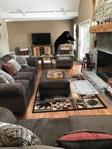 """Living room with 55"""" T.V."""