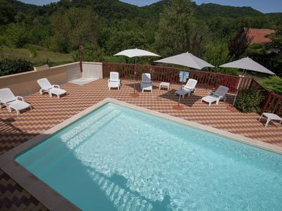 Photo for Holiday home right on the river bank with private swimming pool in Saint-Julien-de-Lampon