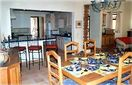 Dining Area Looking Into Kitchen With Snack Bar
