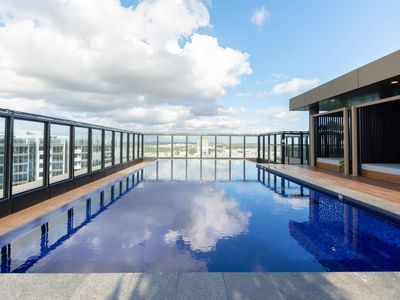 Photo for Japanese Style waterfront apt wt rooftop pool