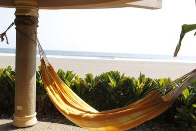 Take a nap in your Hammock under the Bungalow.
