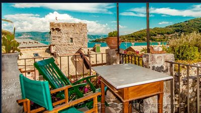 Photo for COTTAGE with a large GARDEN in the walls of PORTOVENERE, a stone's throw from the sea