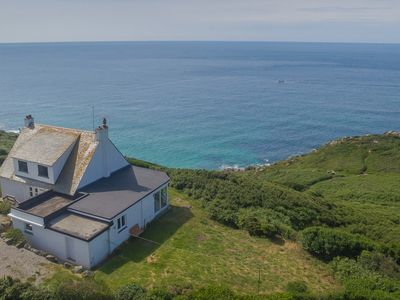 Photo for Stunning sea views. 2 minutes to SW Coast Path. 5 minutes to Porth Chapel Beach