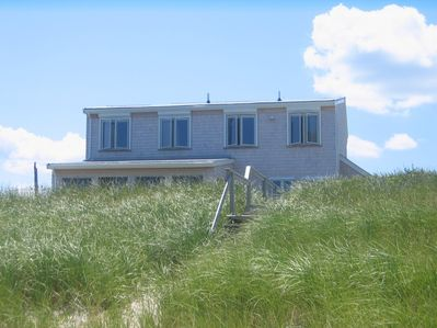 Beach House with sun reflected in the beach grass in July