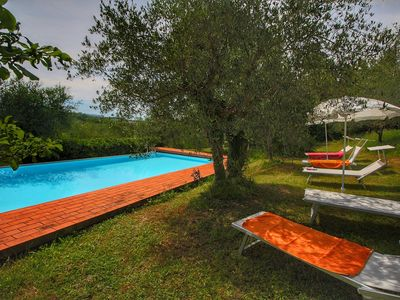 Photo for Farmhouse apartment surrounded by cypresses and olive trees, with panoramic view