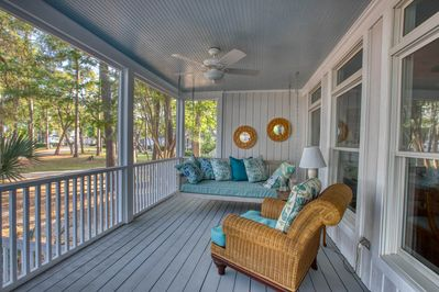 The beautiful wrap-around screened porch with swing bed