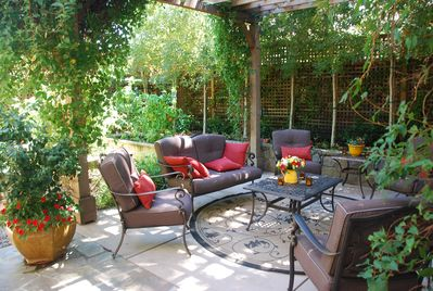 Seating for six under the vine-covered pergola.