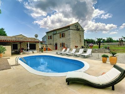 Photo for Stone villa with private pool, 5 bedrooms, air conditioning, Wi-Fi, barbecue, deck chairs, umbrella and children's playground