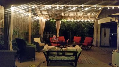 SUMMER EVENING ON THE COVERED BACK PORCH