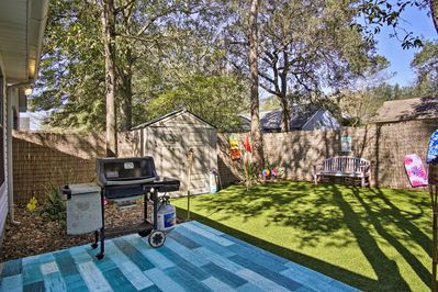 Grill out and chill out in the backyard.