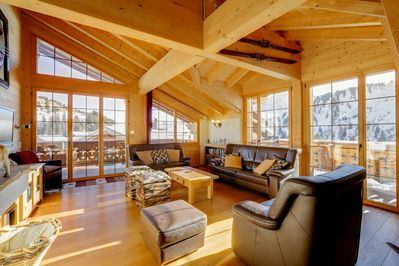 The bright and spacious living room with commanding views of the area